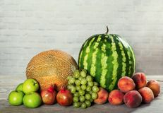 Fresh organic fruits mix. On wooden surface Royalty Free Stock Photos