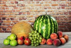 Fresh organic fruits mix. On wooden surface Royalty Free Stock Images