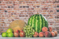 Fresh organic fruits mix. On wooden surface Stock Photography