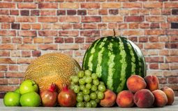 Fresh organic fruits mix. On wooden surface Stock Image