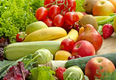 Fresh organic fruits and vegetables. On a table royalty free stock photos
