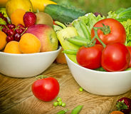 Fresh organic fruits and vegetables in bowls Royalty Free Stock Photography