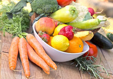 Fresh organic fruits and vegetables - healthy food. On table Stock Images