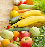 Fresh organic fruits and vegetables. On a table royalty free stock image