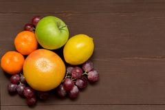 Fresh organic fruits on wooden background stock photo