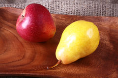 Fresh organic fruits on wooden Serving tray. Assorted pear and apple. Stock Photo