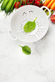 Fresh organic garden vegetables and colander Royalty Free Stock Image