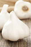 Fresh Organic Garlic Cloves. On a background Royalty Free Stock Photo