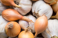 Fresh organic garlic and onions close up, clean eating concept Stock Photos
