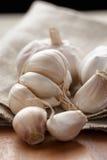 Fresh organic garlic on sack cloth Royalty Free Stock Photography