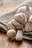 Fresh organic garlic on sack cloth Royalty Free Stock Images