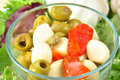 Fresh organic garlic salad with green olive. Some fresh organic garlic salad with green olive royalty free stock images
