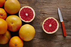Fresh organic grapefruit sliced with orange knife Stock Photos