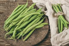 Fresh organic green beans on a rustic wooden  table top view. Fresh organic green beans on rustic wooden table top view Royalty Free Stock Photo