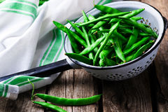 Fresh, organic green beans in a vintage colander Royalty Free Stock Photo