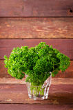 Fresh organic green curly parsley in a glass Stock Photo