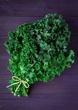 Fresh Organic Green Kale on a Purple Wooden Surface royalty free stock photos