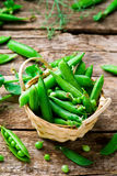 Fresh, organic green peas. Selective focus Stock Photos