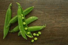 Fresh organic green peas on a wood Stock Photo