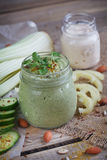 Fresh organic green smoothie with cucumber, parsley and celery. On wooden background Stock Image