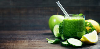 Fresh organic green smoothie - detox, diet and healthy food concept stock photography