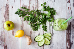 Fresh organic green smoothie with parsley, apple, cucumber, ging Royalty Free Stock Image