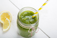 Fresh organic green smoothie with salad, apple, cucumber, pineap Stock Images