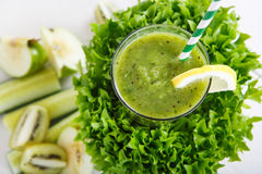 Fresh organic green smoothie with salad, apple, cucumber, pineap Royalty Free Stock Image