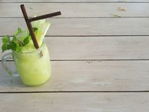 Summer drink : A glass jar of apple juice smoothie is on the wooden table Royalty Free Stock Photo