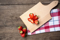 Fresh organic home grown strawberries on wooden table Royalty Free Stock Photography