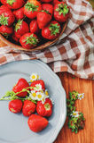 Fresh organic home growth strawberries on wooden table in plate Royalty Free Stock Photography