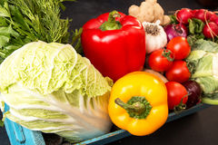 Fresh organic homegrown vegetables in blue wooden box Royalty Free Stock Photos