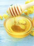 Fresh organic honey alternative food , organic aroma sweet. Fresh honey, yellow chrysanthemum flower on wooden background     tasty alternative food sweet aroma stock photo