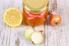 Fresh organic honey in glass jar, onions and lemon, healthy nutrition and strengthening immunity Stock Image