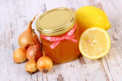 Fresh organic honey in glass jar, onions and lemon, healthy nutrition and strengthening immunity Stock Images
