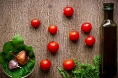 Fresh organic ingredients for salad making: spinach, tomatoes, sprouts, basil, olive oil on rustic background, top view. Flat lay with place for text. Vegan Stock Images