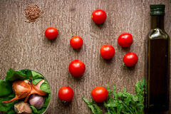 Fresh organic ingredients for salad making: spinach, tomatoes, sprouts, basil, olive oil on rustic background, top view. Stock Image