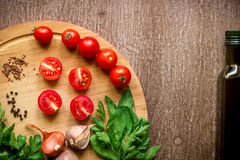 Fresh organic ingredients for salad making: spinach, tomatoes, sprouts, basil, olive oil on rustic background, top view. Flat lay with place for text. Vegan Stock Photo