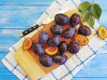 Fresh organic juicy dessert gourmet plum vitamin natural autumn delicious on a table , blue wooden background, towel. Fresh organic plum on a blue wooden stock photos