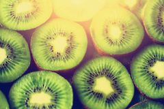 Fresh organic kiwi fruit sliced. Food frame with copy space for your text. Banner. Green kiwi circles background.  Royalty Free Stock Photo