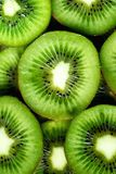 Fresh organic kiwi fruit sliced. Food frame with copy space for your text. Banner. Green kiwi circles background.  Royalty Free Stock Images