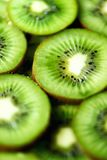 Fresh organic kiwi fruit sliced. Food frame with copy space for your text. Banner. Green kiwi circles background.  Stock Photography