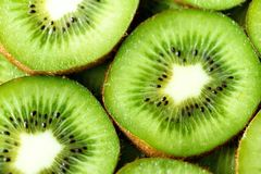 Fresh organic kiwi fruit sliced. Food frame with copy space for your text. Banner. Green kiwi circles background.  Royalty Free Stock Photos