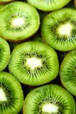 Fresh organic kiwi fruit sliced. Food frame with copy space for your text. Banner. Green kiwi circles background.  Stock Photo