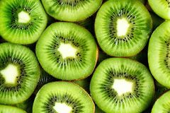 Fresh organic kiwi fruit sliced. Food frame with copy space for your text. Banner. Green kiwi circles background.  Stock Image