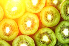 Fresh organic kiwi fruit sliced. Food frame with copy space for your text. Banner. Green kiwi circles background. Summer. Food concept Royalty Free Stock Photo