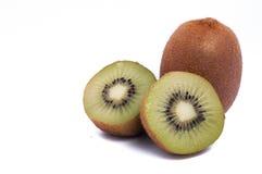 Fresh organic kiwi one whole and two half isolated on white background. Green stock photos