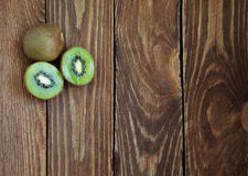 Fresh organic kiwis on a wooden table. Top view stock image
