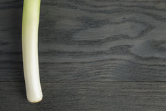 Fresh organic leek on vintage oak table. With copyspace for text Royalty Free Stock Photos