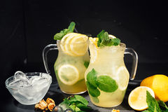 Fresh, organic lemonade drink with delicious lemons, lime and mint royalty free stock photography